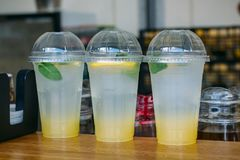 Tree plastic cups with lemonade in fast food cafe Royalty Free Stock Images