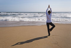 Tree Pose on beach Stock Photos