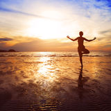 Tree position in yoga stock photo