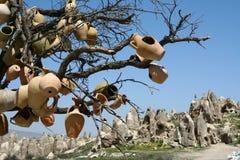 Tree with pottery Stock Photo