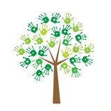 Tree with prints of hands instead of leaves. Tree with prints of a hands instead of leaves Royalty Free Stock Image