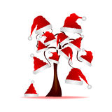 Tree with red hat of Santa Claus Stock Photos