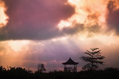 Tree and religious gazebo against the sky Royalty Free Stock Images