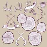 Tree rings set with bow,antlers and saw Stock Photo