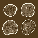Tree Rings Set Saw Cut Trunk on a Brown Background. Vector Stock Photo