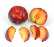 Tree Ripe Red Plums and Slices Stock Photography