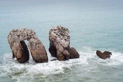 Tree rocks at the Cantabrian sea. Tree big rocks at the Cantabrian sea Royalty Free Stock Image
