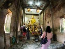Tree root covering ancient temple : Wat Bang Kung at Amphawa Stock Image