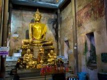 Tree root covering ancient temple : Wat Bang Kung at Amphawa Royalty Free Stock Image