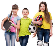 Tree scoolchildren with sport equipment in hands Royalty Free Stock Photography