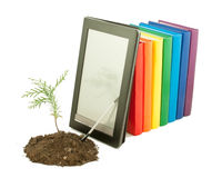 Tree seedling with row of books and e-book. Tree seedling with row of books and electronic book reader behind isolated on white Royalty Free Stock Photography