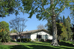 Tree shaded home in Laguna Woods, Caliornia. Image shows a tree shaded home in a park like setting in the heart of the senior retirement community of Laguna Royalty Free Stock Photos