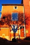 Tree shadow I. Tree shadow on a house in Roussillon, France royalty free stock photo