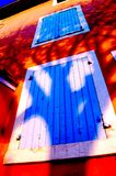 Tree shadow III. Tree shadow on a house in Roussillon, France stock image