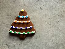 Tree-shaped gingerbread cookie iced, decorated with candies for Christmas Royalty Free Stock Image