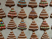 Free Tree-shaped Gingerbread Cookies Iced, Decorated With Candies For Christmas Royalty Free Stock Photos - 63857668