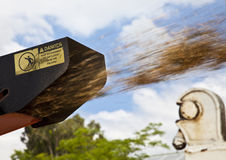 Tree shredder in action. Wood chipping machine spits chips into truck Royalty Free Stock Image