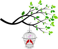 Tree silhouette with bird in a cage Royalty Free Stock Photography