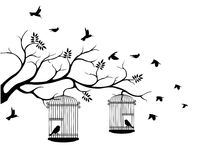 Tree silhouette with bird flying Royalty Free Stock Photos