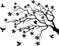 tree silhouette with bird flying Stock Image