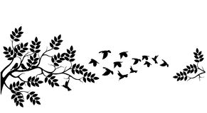 Tree silhouette with birds flying Stock Image