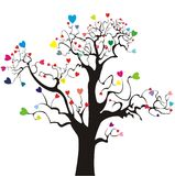 Tree silhouette with colored hearts Royalty Free Stock Photo