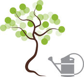 Tree silhouette and watering can Royalty Free Stock Photography