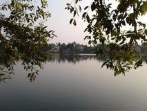 Tree sky and lake. A nice lake, trees and sky near a town Stock Photos