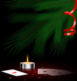 Tree, small candle and cards. Christmas ree, small burning candle and cards Stock Photography