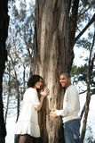 Tree and smiling couple Royalty Free Stock Photography