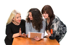Tree smiling women with tablet pc Royalty Free Stock Images