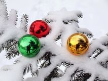 Tree, snow and three toys Royalty Free Stock Image