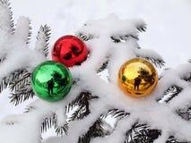 Tree, snow and three toys Royalty Free Stock Image