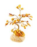 Tree statuette made of amber Stock Image