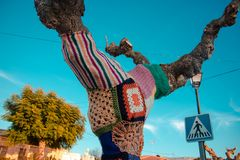 Tree with storm yarn. Artistic and creative street art. Colored. Wool in the trees. Street landscape stock photos