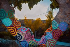 Tree with storm yarn. Artistic and creative street art. Colored. Wool in the trees. Street landscape royalty free stock photo