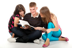 Tree students over a white background Stock Photography