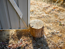 Tree stump door stopper. Tree stump as door stopper stock image