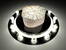 Tree stump on illuminated stage Stock Photo