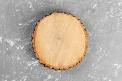 Tree stump round cut with annual rings on cement background. top view with copy space.  stock photo