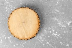 Tree stump round cut with annual rings on cement background. top view with copy space.  stock image