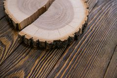 Tree stump round cut with annual rings on wooden background from top view stock photography