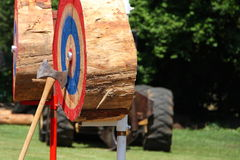 Tree Stump Target with Axe. Long handled double bit axe thrown at tree stump target Stock Photo