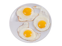 Tree sunny side up eggs on plate isolated Stock Photo