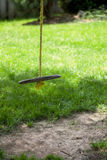 Tree swing. A tree swing with yellow rope, surrounded by grass Stock Photography