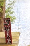 Tree swing at the lake house Royalty Free Stock Image