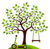 Tree with swing and scooter Royalty Free Stock Photo