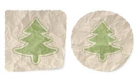 Tree symbol. Crumpled slip of paper and a tree symbol Stock Image