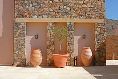 Stone wall with tree terracotta pots (Greece) Stock Photos