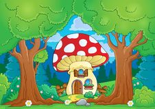 Tree theme with mushroom house Stock Images